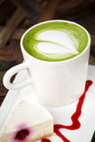 Close up hot green tea and milk cream Royalty Free Stock Photos