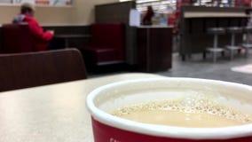 Close up hot Mccafe coffee at mcdonalds stock video
