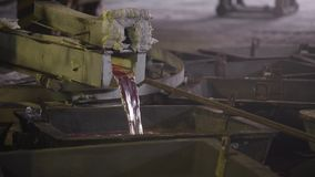 Close-up, the hot metal is drained from the furnace. Creek molten aluminum. Metallurgical industry. The final stage stock footage