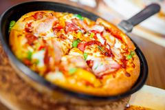 Close-up of hot pizza with fresh ingredients and vegetables Stock Images
