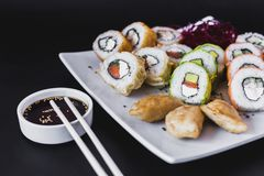 Close up Hot sushi rolls table with gyoza. Avocado japanese colorful restaurant seaweed delicious nori cucumber seafood traditional tray shrimp plate salmon royalty free stock photos