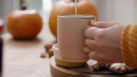 Hot tea with honey stock video footage
