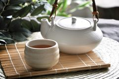 Close up Hot Tea Set on Bamboo Mat. Background stock photography