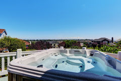 Close-up of hot tub. Luxury house exterior. Royalty Free Stock Image