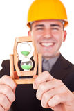 Close-up of hourglass and engineer Stock Photo