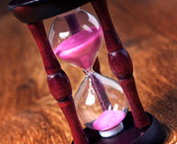 Close-up Hourglass on wood background, antique tone Stock Photography