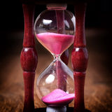 Close-up Hourglass on wood background, antique tone Royalty Free Stock Image