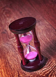 Close-up Hourglass on wood background, antique tone Royalty Free Stock Photos