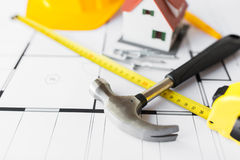 close up of house blueprint with building tools stock photography - Home Building Tools