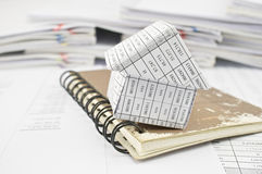 Close up house and closed old notebook on finance account Stock Photo