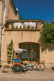Close-up of house and colorful rickshaw on a street of Lourmarin. Close-up of house and colorful rickshaw on a street of the historical village of Lourmarin Royalty Free Stock Image