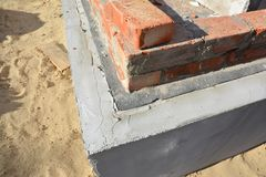 Close up on house foundation wall waterproofing with bitumen membrane stock photo