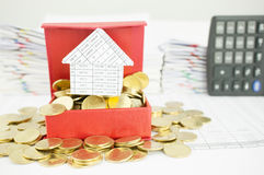 Close up house on gold coin in red box Royalty Free Stock Images
