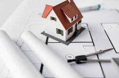 Close up of house model on architectural blueprint Stock Photo