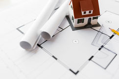 Close up of house model on architectural blueprint Stock Photography