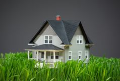 Close up of house model with green grass Royalty Free Stock Image