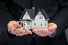 Close up of house model on hands Stock Photo