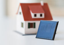 Close up of house model and solar battery or cell Royalty Free Stock Photography