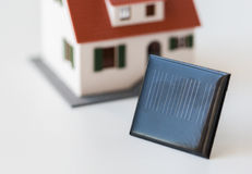 Close up of house model and solar battery or cell Stock Images
