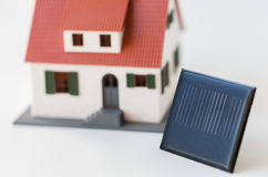 Close up of house model and solar battery or cell Stock Photo
