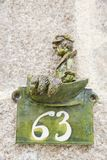 Close-up of a house number made with terracotta with creative design. NORMANDY, FRANCE royalty free stock photography