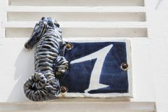 Close-up of a house number made with terracotta with creative design. NORMANDY, FRANCE stock images