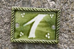 Close-up of a house number made with terracotta with creative design. NORMANDY, FRANCE stock photo