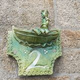 Close-up of a house number made with terracotta with creative design. NORMANDY, FRANCE royalty free stock photos