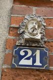 Close-up of a house number made with terracotta with creative design. NORMANDY, FRANCE royalty free stock photo