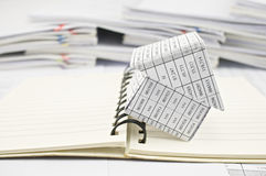 Close up house and open notebook Royalty Free Stock Photos
