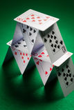 Close up of house of playing cards on green cloth Stock Photography