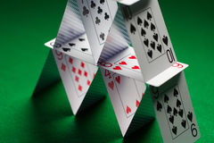 Close up of house of playing cards on green cloth Stock Image
