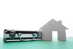 Close up of houses cut out of paper with box. Stock Photo