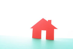 Close up of houses cut out of paper. Royalty Free Stock Image