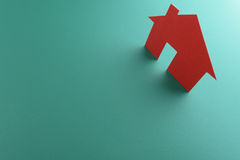 Close up of houses cut out of paper. Royalty Free Stock Photography