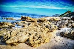 Close up of a huge rock in Castelsardo shoreline Stock Image