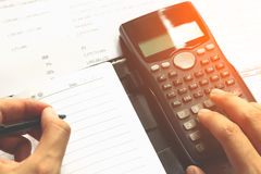 Close-up of Human accountant making calculations while sitting a stock photos