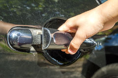 Close up of human child hand opening car door Stock Photography