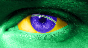 Close up on human eye with the flag of Brazil Stock Photos