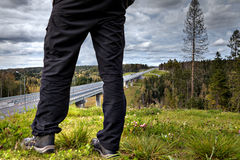 Close-up of human feet on background of forest roadway. Stock Photography