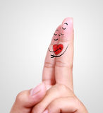 Close up of human finger falling in love Stock Image