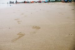 Close up on human foot print on the sand beach Royalty Free Stock Photography