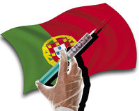 Close up of human hand with cash injection on portuguese flag Stock Photography