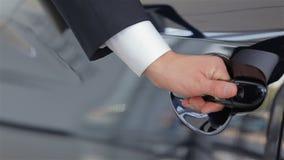 Close up human hand opening car door stock video footage