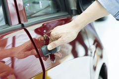 Close up of human hand opening door of car. Royalty Free Stock Photography