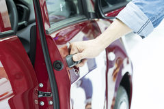 Close up of human hand opening door of car. Stock Images