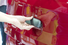 Close up of human hand opening door of car. Royalty Free Stock Photo