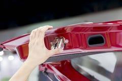 Close up of human hand opening door of car. Stock Photos