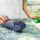 Close up of human hand over payment machine in drug store Stock Photography
