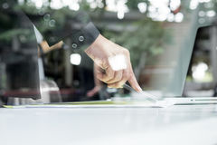 Close-up of human hand with pen pointing at paper while explaini Stock Photo